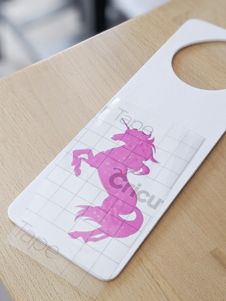 applying vinyl to make a diy door knob hanger for a kids room
