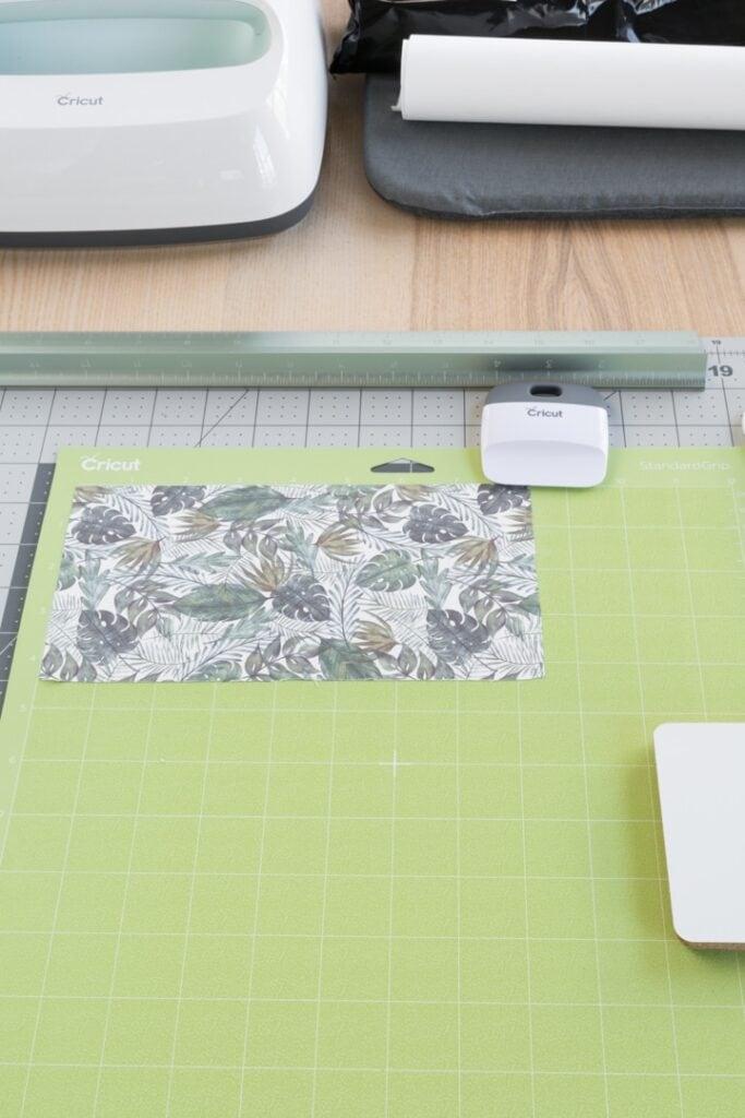 applying a sheet to a green mat