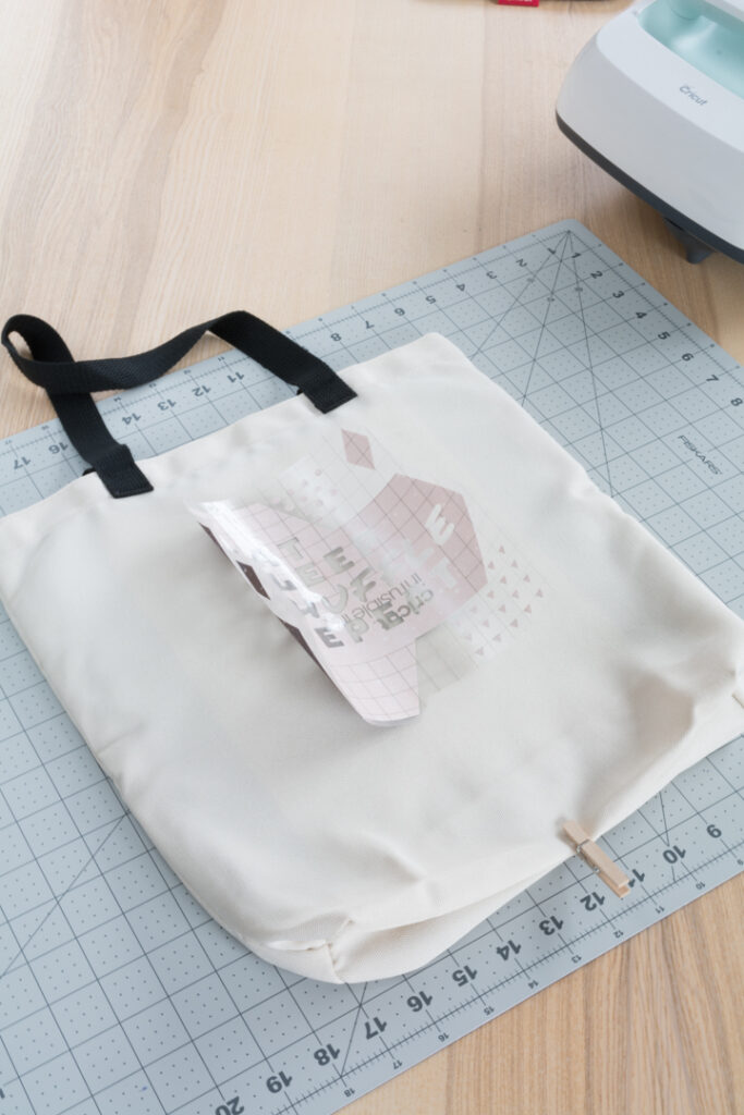 transferring the Infusible Ink design to the tote bag