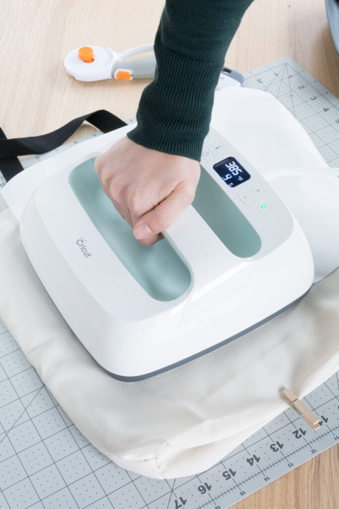 transferring the Infusible Ink design to the tote bag using an EasyPress 2