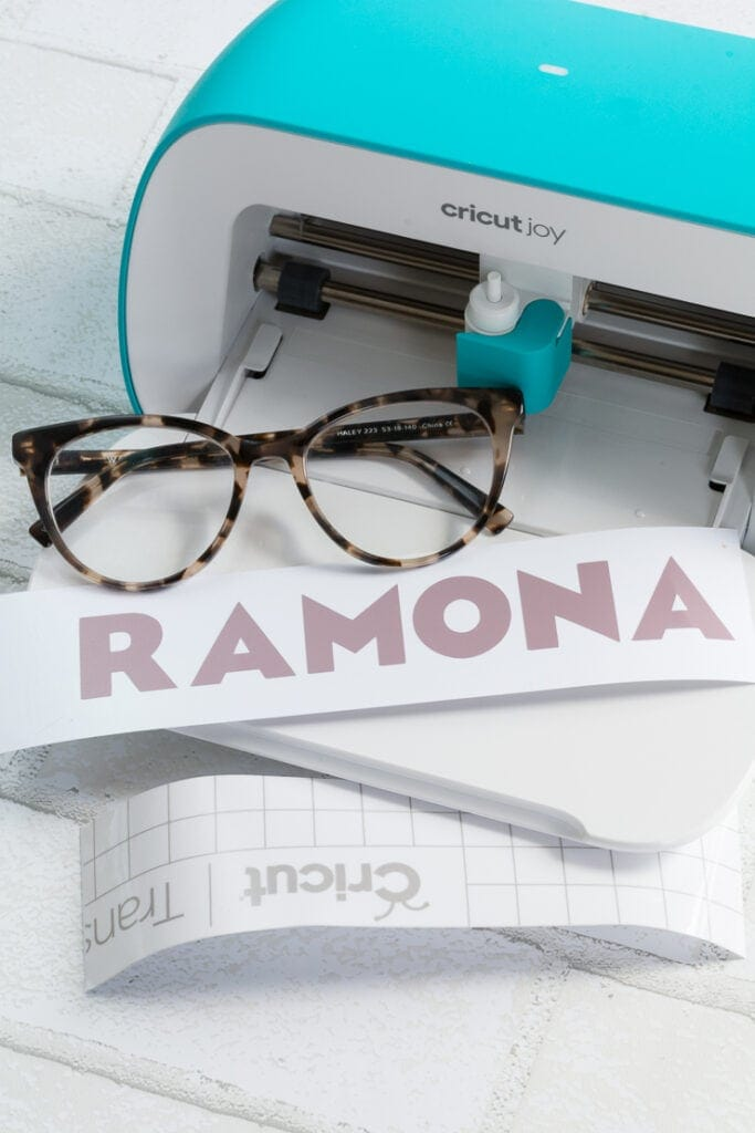 the name RAMONA cut out of vinyl on the Cricut Joy