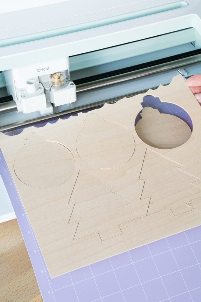 pieces cut out of basswood using the knife blade on a Cricut Maker
