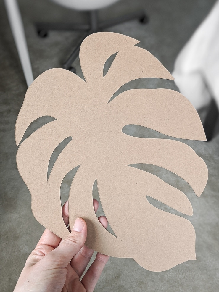 monstera leaf cut out on a Cricut Maker using chipboard