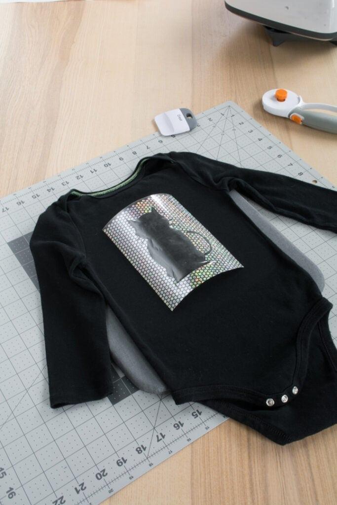 Cricut Holographic Mosaic Iron On on a black baby bodysuit