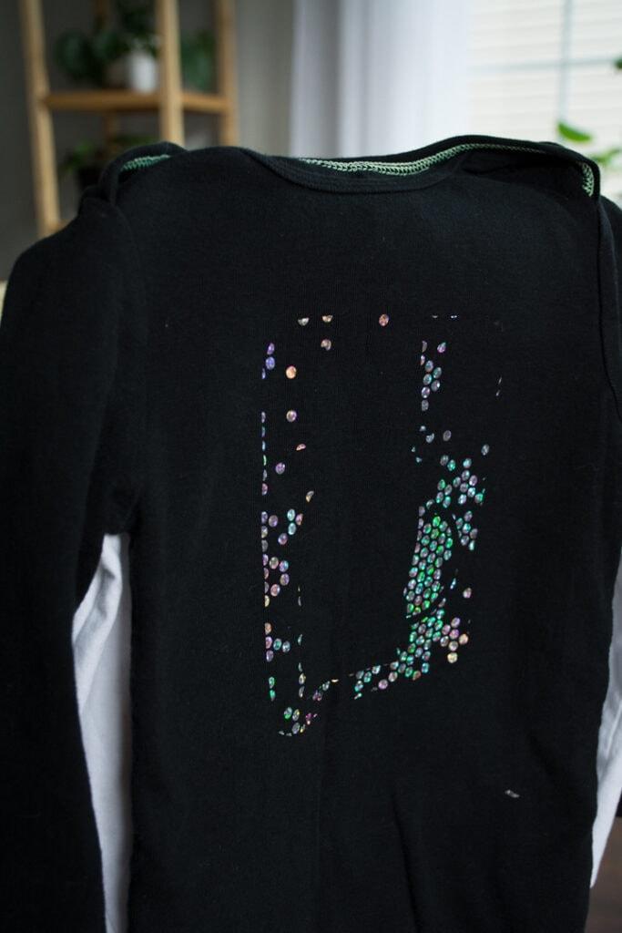 failed Cricut Holographic Mosaic Iron On on a black baby bodysuit