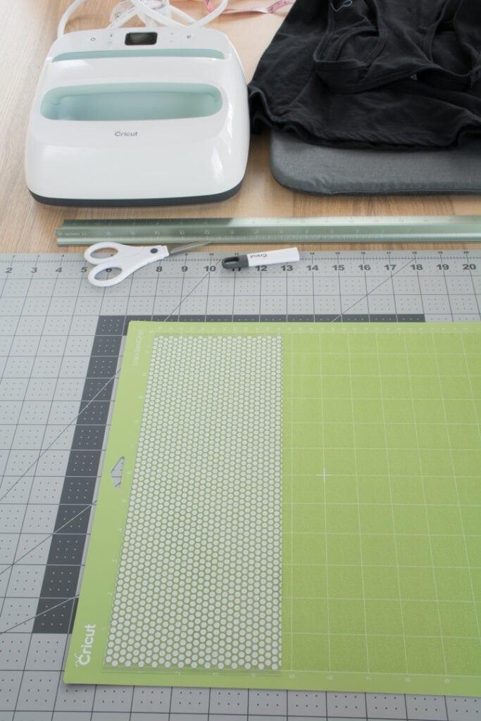 Cricut Holographic Mosaic Iron On on a green grip mat