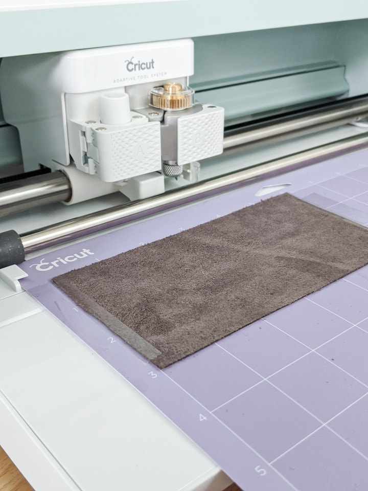 cutting the DIY leather hair bow materials on the Cricut Maker