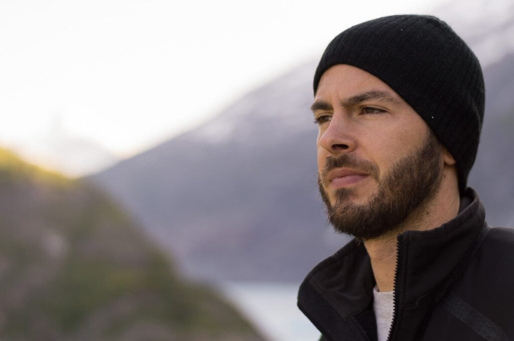 man wearing a beanie hat with a beard