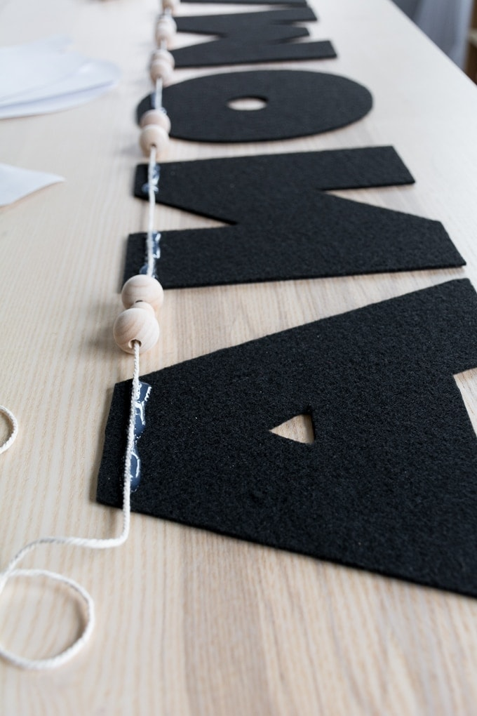 gluing the twine on the felt letters