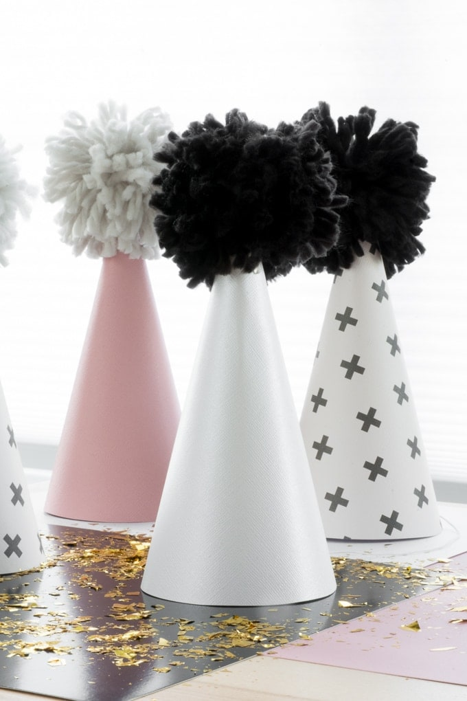 DIY scrapbook paper and yarn party hats