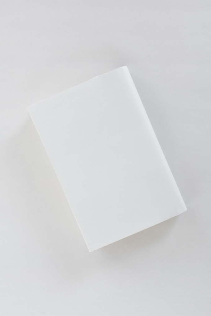 covering the book with paper