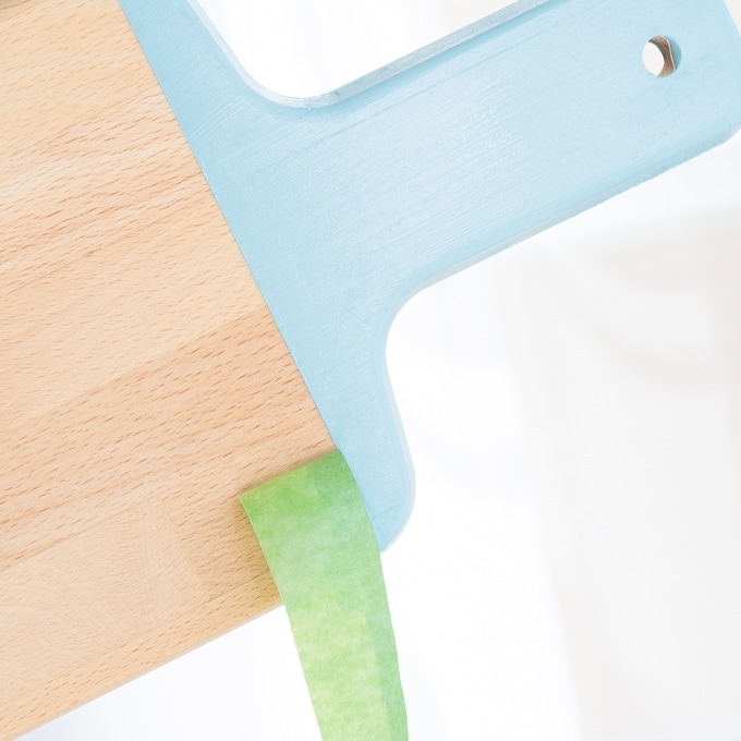 removing painter's tape from the painted cutting board