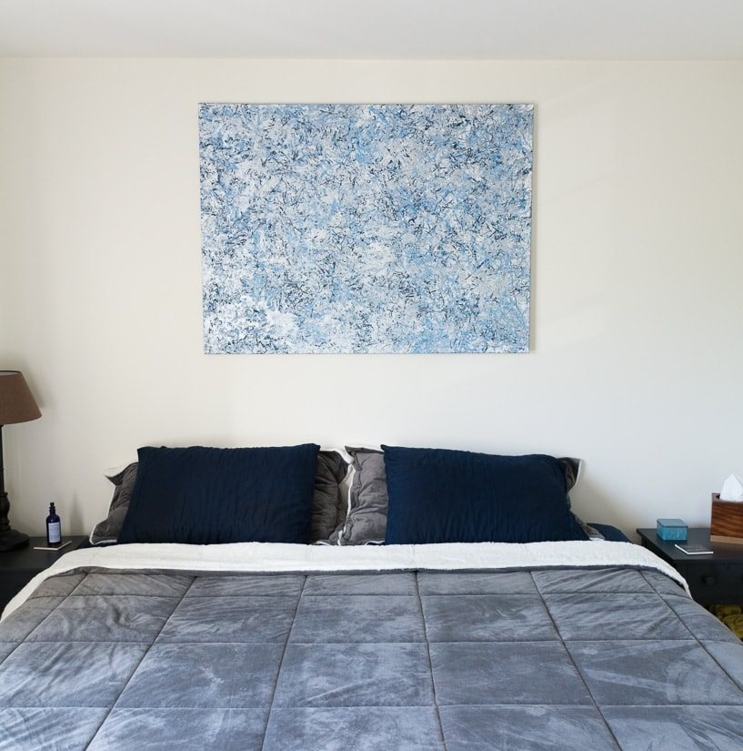 finished feather duster painting art hanging over a bed