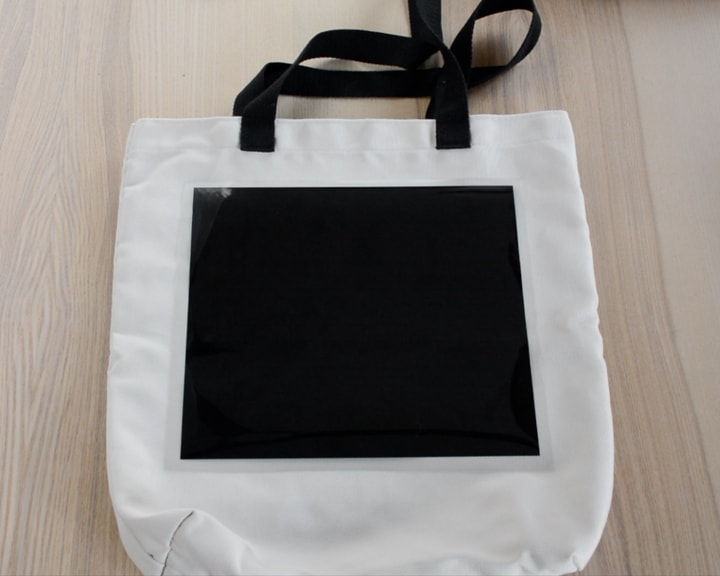 layering iron-on vinyl to make a tote bag