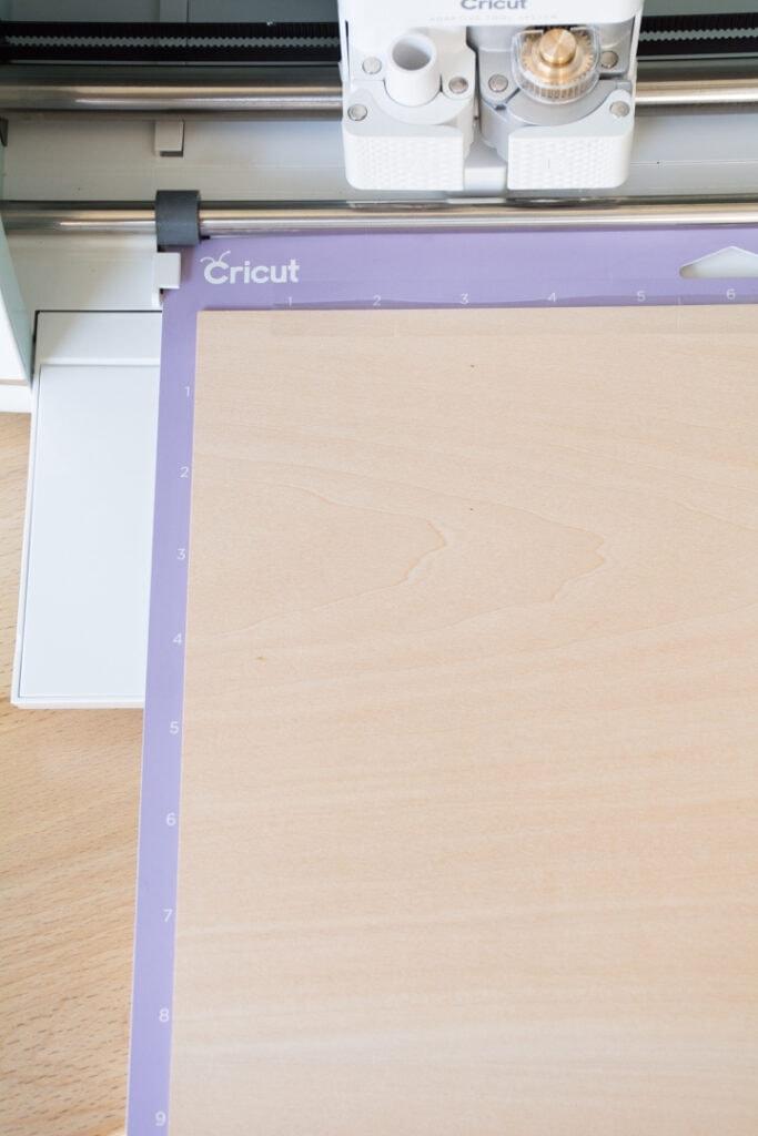 Basswood on a mat cutting in a Cricut Maker