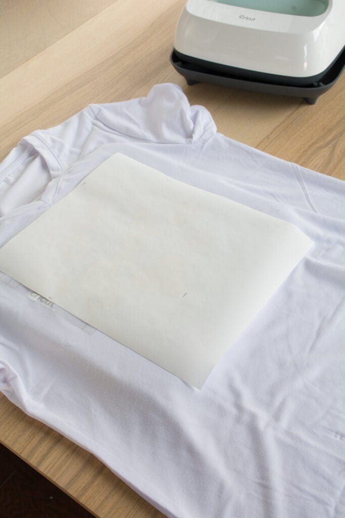 piece of kraft paper on top of the t-shirt