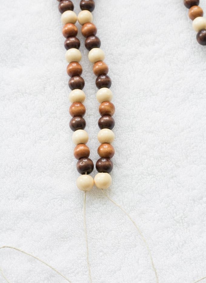 threading wooden beads