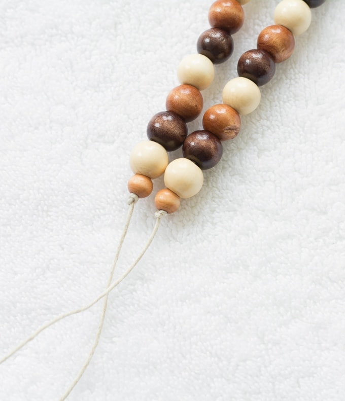 tying off the tope ends on wooden beads