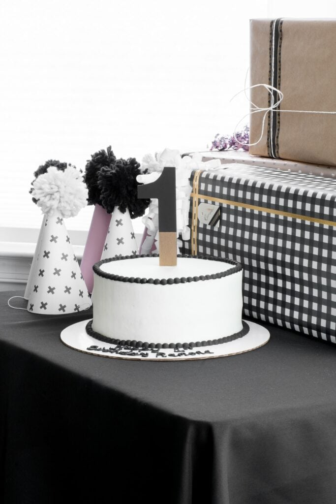 gorgeous black and white cake with a number 1 cake topper