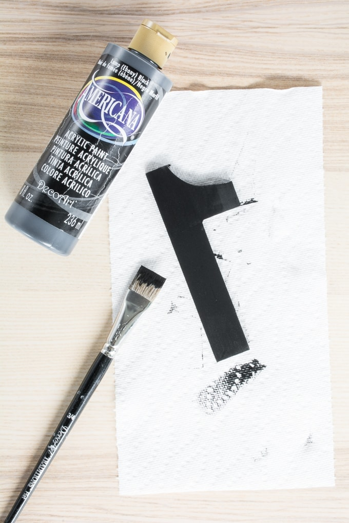 painting a wooden number 1 black