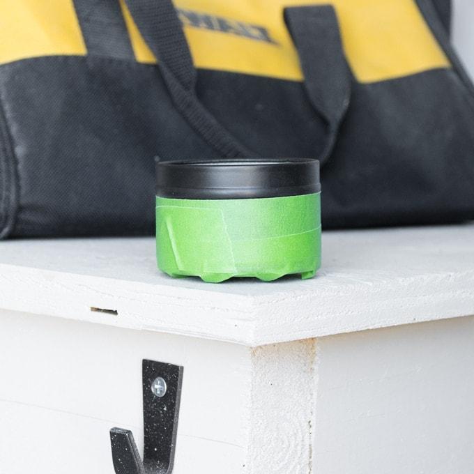 spray painting the tea tin