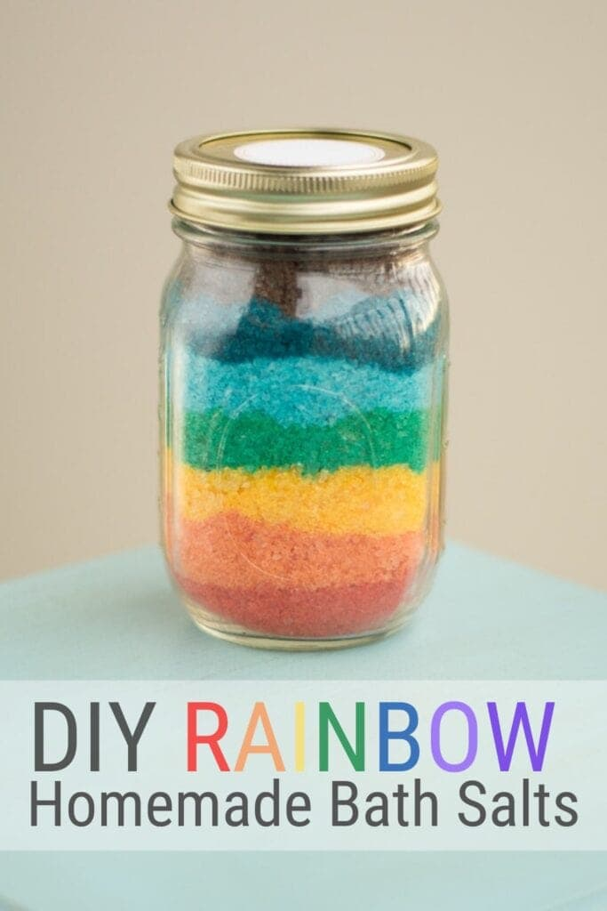 pinnable graphic with a picture of finished rainbow homemade bath salts and text overlay