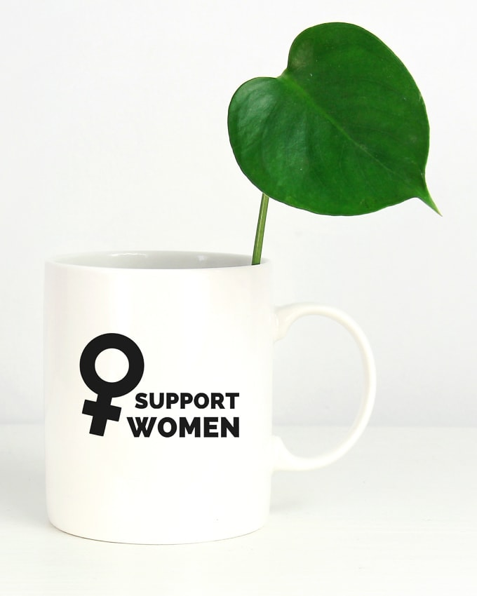 feminist coffee mug that says support women with a female symbol