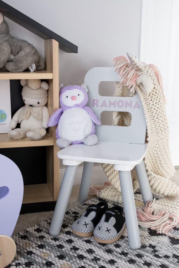 kids chair with a vinyl decal of a name on it