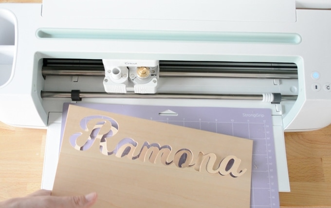 removing basswood from the cutting mat after cutting it with a Cricut Maker Knife Blade