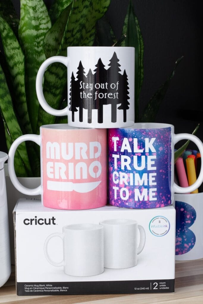 mugs made on the Cricut mug press sitting on top of a box of blank Cricut mugs