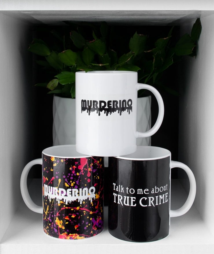 """mugs made on the Cricut mug press that say """"murderino"""" and """"talk to me about true crime"""""""