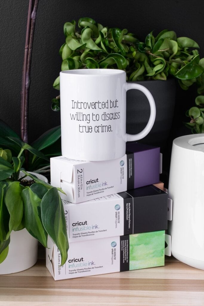 Cricut infusible ink pens in a mug that was designed using the Cricut Mug Press