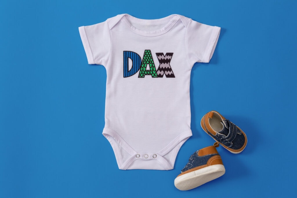personalized baby bodysuit made using Cricut Infusible Ink