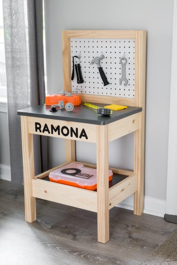 DIY kids workbench personalized using Cricut adhesive vinyl