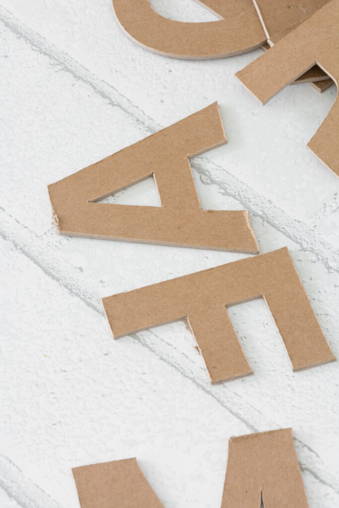 letters cut out of chipboard on a Cricut Maker with a knife blade