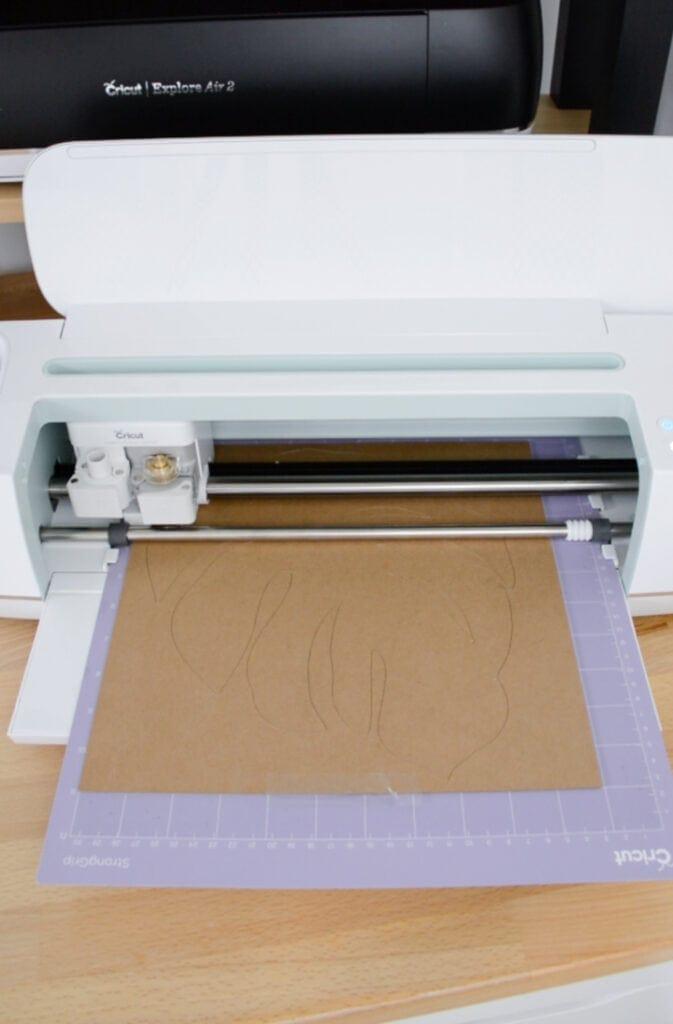 cutting Cricut chipboard on a purple strong grip mat