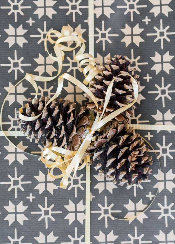 presents adorned with ribbons and pine cones