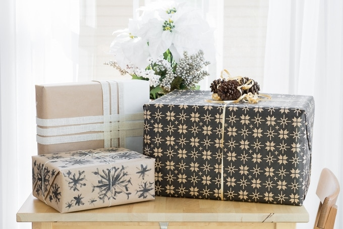 presents wrapped in DIY wrapping paper on a table