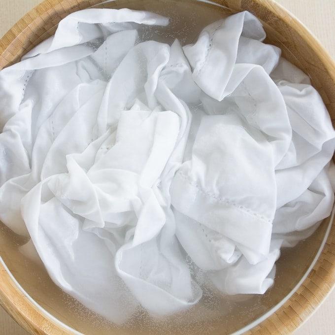 white cotton napkin submerged in soda ash water