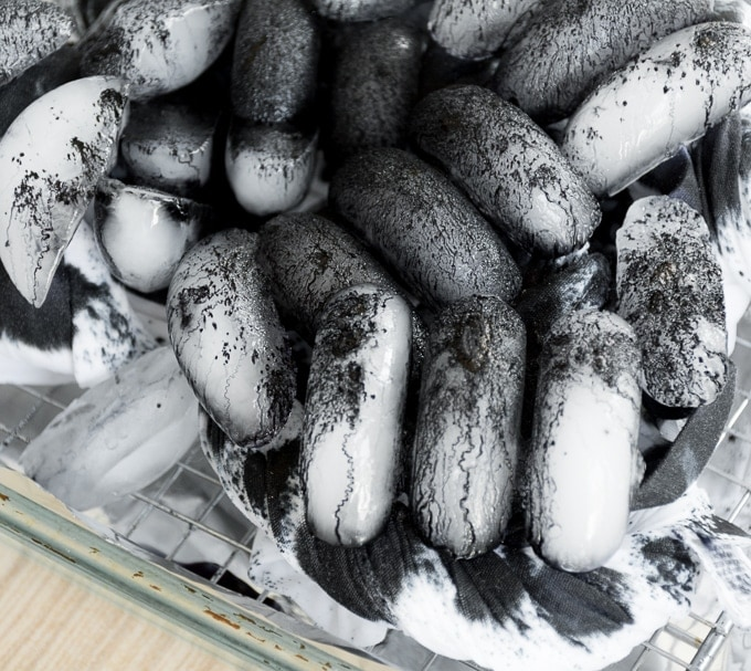black dye powder melting over ice