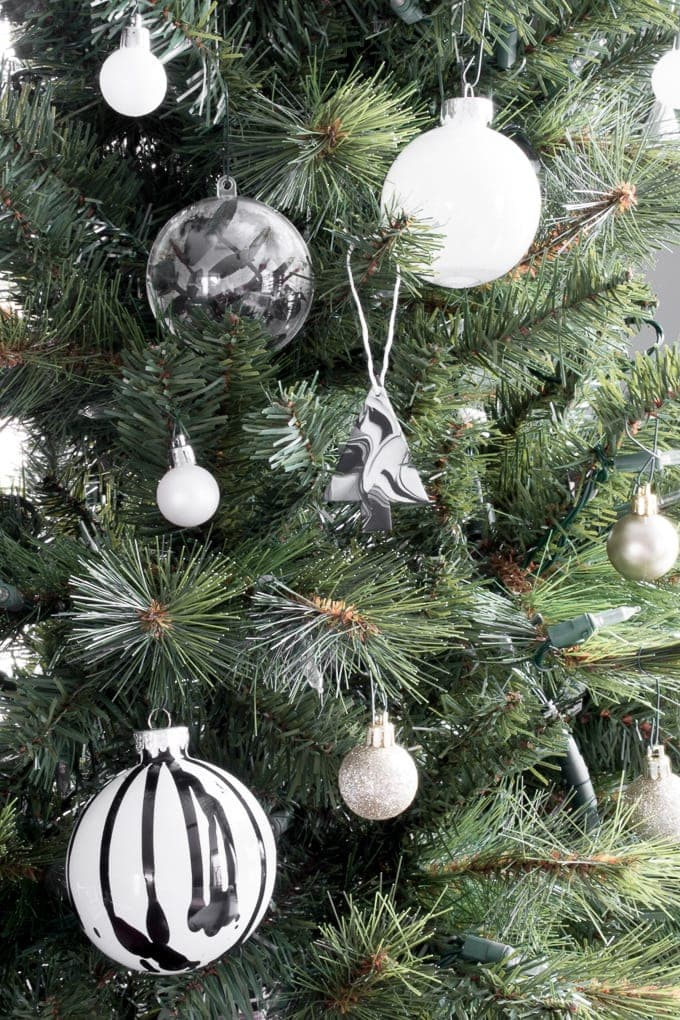 marbled Christmas ornaments using clay hanging on a tree