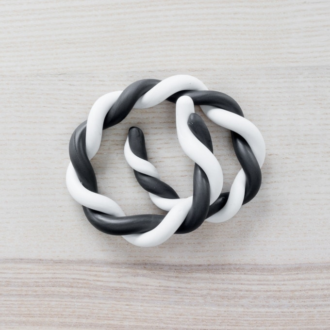 white and black rolled out pieces of clay wrapped around each other