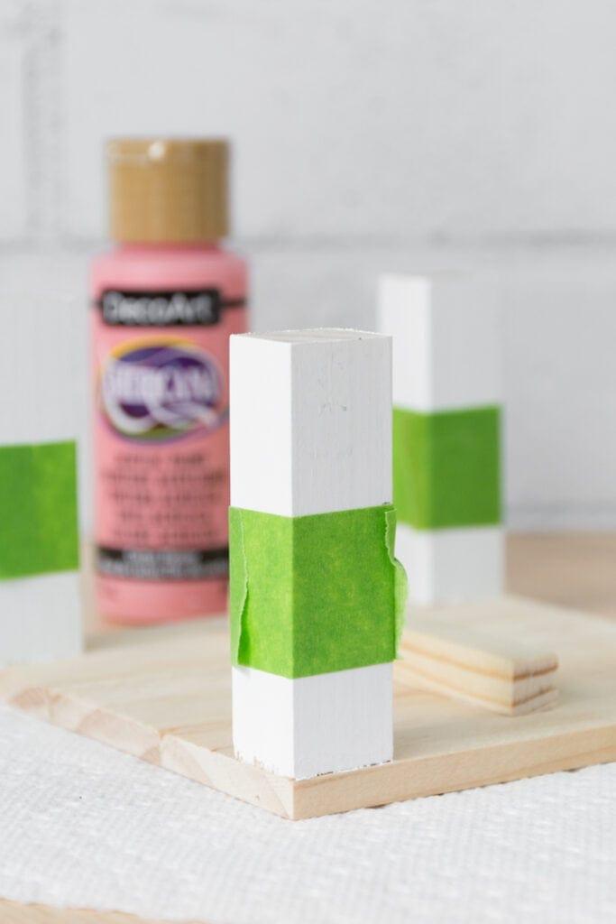 adding painter's tape to te mini plant stand legs