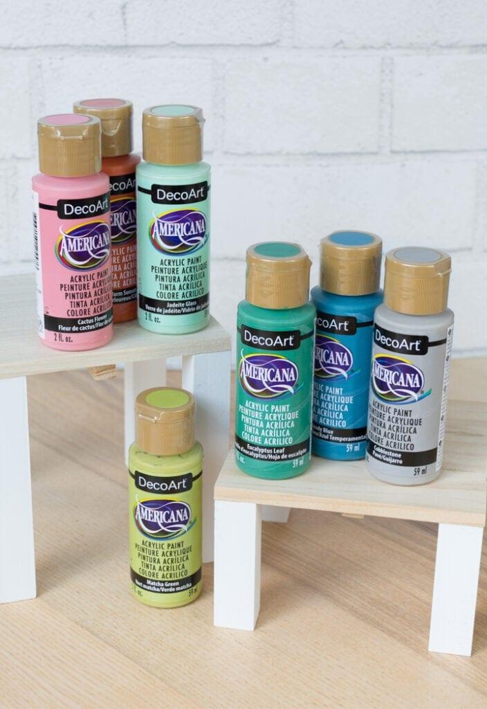 bottles of decoart americana paint on a table