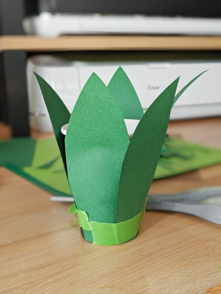 applying the paper pieces to make the pineapple head piece
