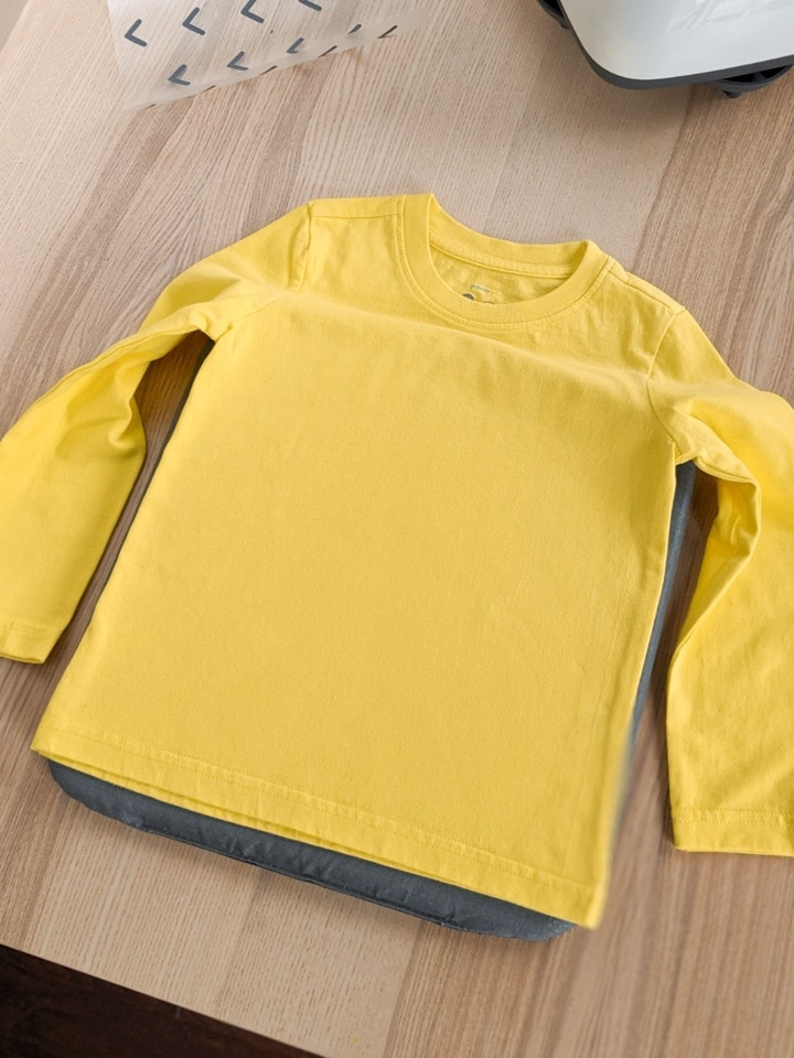 yellow shirt on a table