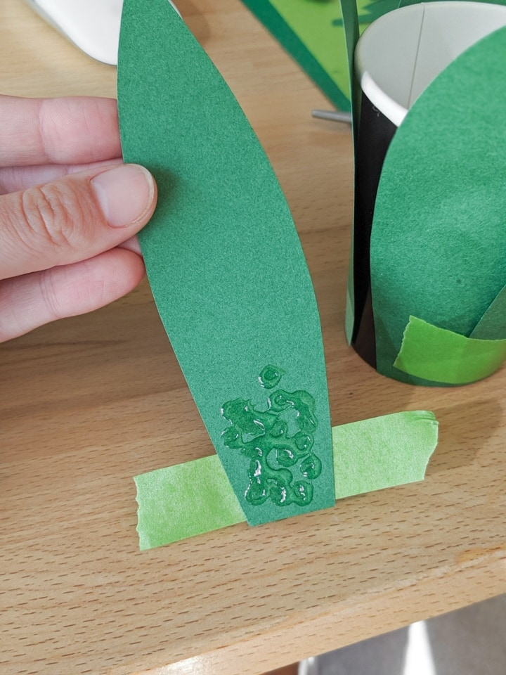 piece of green paper with glue