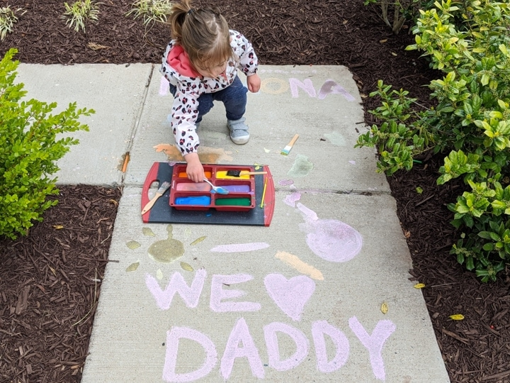 little girl painting with DIY Sidewalk Chalk paint