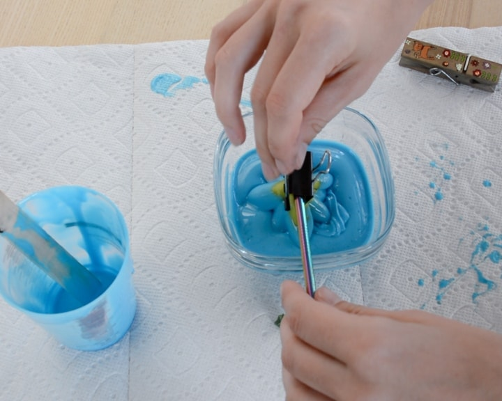 pouring a two-part liquid silicone mixture into a bowl