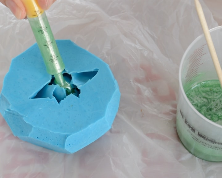 pouring resin into a silicone mold